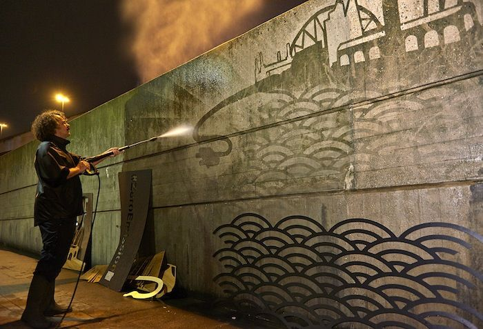 Nissan LEAF-powered Reverse Graffiti mural in Waterloo, London highlighting London's battle with air quality – For more info call 0208 541 3434